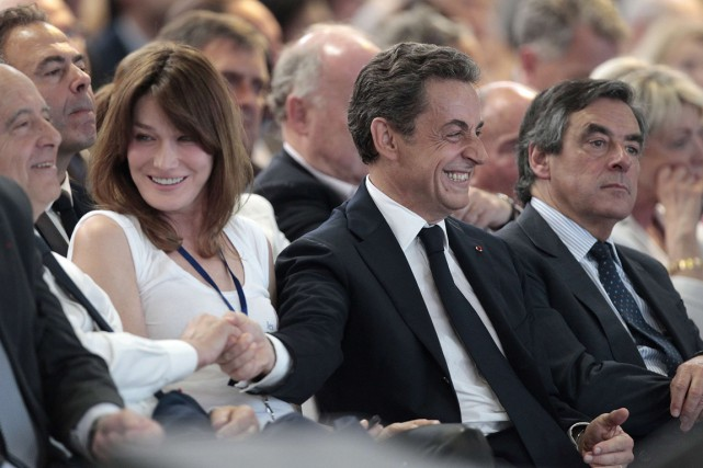 Alain Juppé (à gauche), Nicolas Sarkozy (au centre)... (PHOTO CHARLY TRIBALLEAU, ARCHIVES AFP)