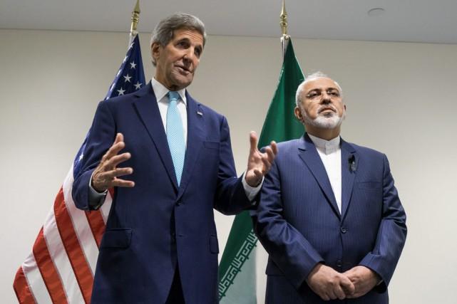 Le Secrétaire d'État John Kerry et son homologue... (AP, Craig Ruttle)