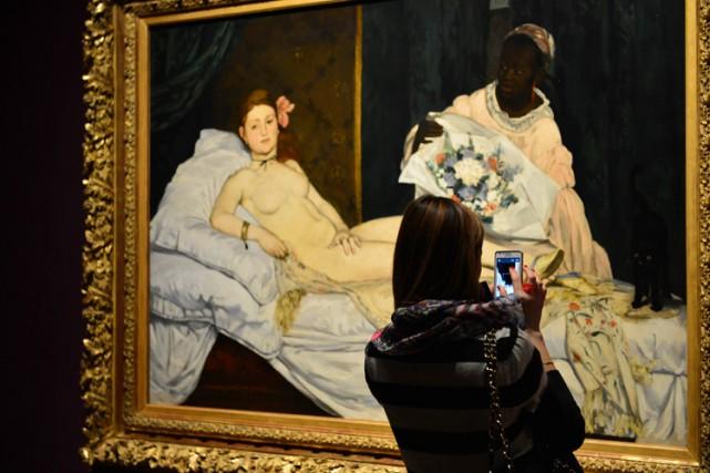 Olympiareprésente au premier plan une jeune femme nue... (ARCHIVES REUTERS)