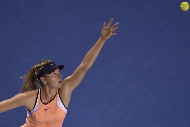 Maria Sharapova est devenue la première joueuse à atteindre le troisième tour... (Associated Press)
