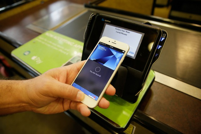 Apple Pay, avec American Express qui n'occupe que... (PHOTO ERIC RISBERG, ARCHIVES ASSOCIATED PRESS)