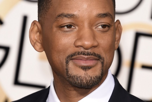 Will Smith suit le mouvement lancé notamment par... (AFP, Jason Merritt)