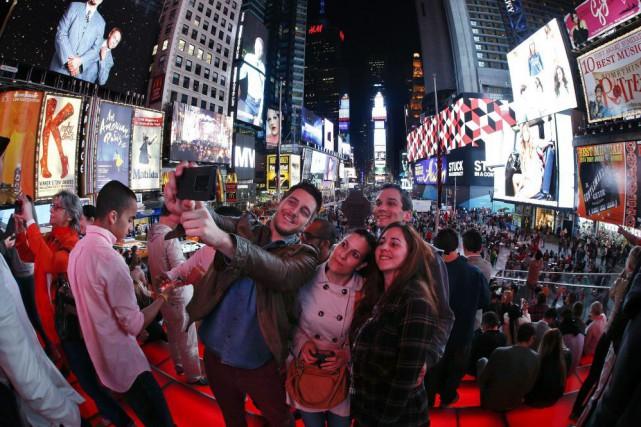 Times Square, une de plus populaires destinations touristiques... (AP, Julie Jacobson)