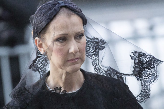 Vêtue d'une robe et d'un voile noirs, Céline... (AFP, Geoff Robins)
