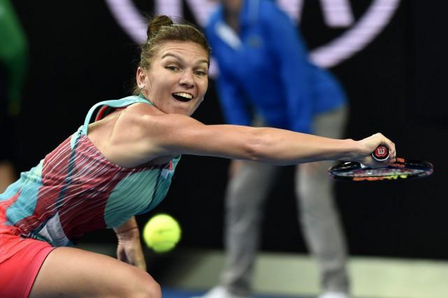 Simona Halepa été éliminée dès le premier tour... (PHOTO ANDREW BROWNBILL, AP)