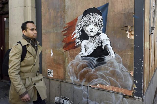 Une nouvelle oeuvre de l'artiste Banksy dénonçant la gestion des réfugiés à... (Agence France-Presse)
