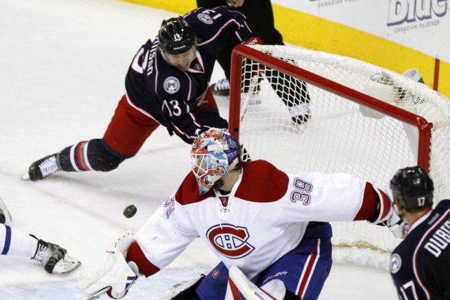 L'ailier Cam Atkinson a inscrit le troisième tour... (Paul Vernon, Associated Press)