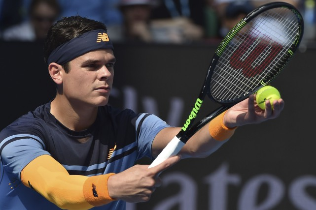 Milos Raonic a réussi 24 as face à Stanislas Wawrinka.... (AFP, Paul Crock)