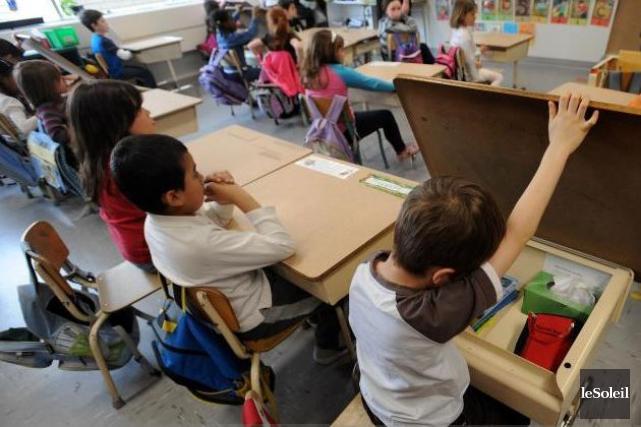 Le bien-être des enfants était central dans le... (PHOTO ERICK LABBÉ, ARCHIVES LE SOLEIL)