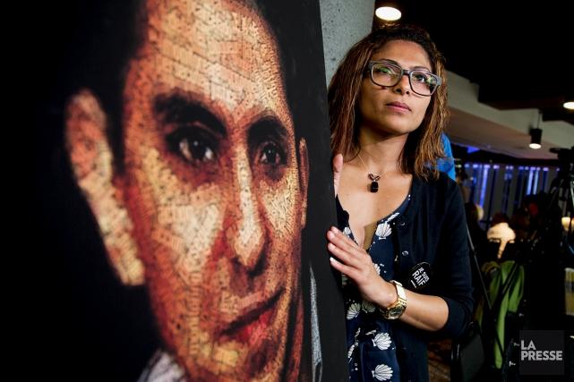 Une affiche représentant Raïf Badawi présentée par sa... (PHOTO ALAIN ROBERGE, ARCHIVES LA PRESSE)