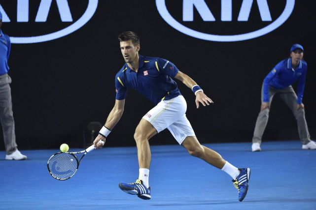 Novak Djokovica pris la mesure du Japonais Kei... (AFP, Saeed Khan)