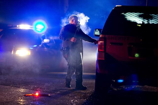 La police d'Oregon (photo) et le FBI ont... (AP, Dave Killen)