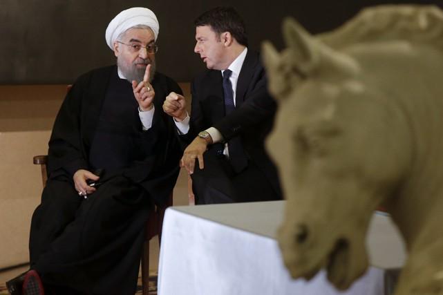 Le président iranienHassan Rohania rencontré lundi le chef... (AP, Gregorio Borgia)