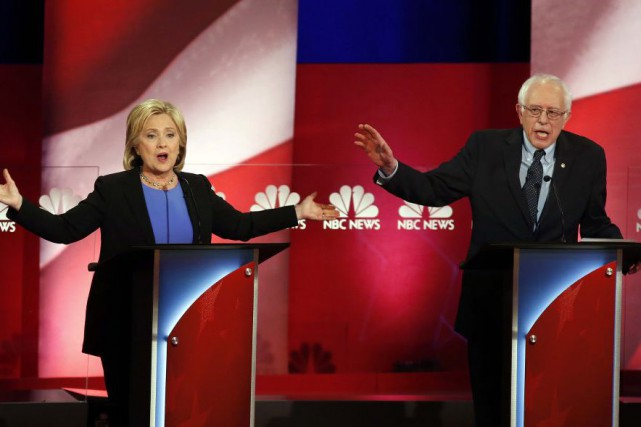 Sur la photo, Hillary Clinton et Bernie Sanders... (Photo Mic Smith, Archives AP)