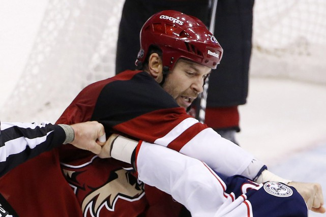 John Scott... (Photo archives AP)