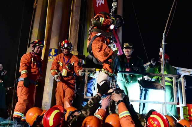 Les quatre hommes ont été atteints grâce à... (PHOTO GUO XULEI, XINHUA/AP)