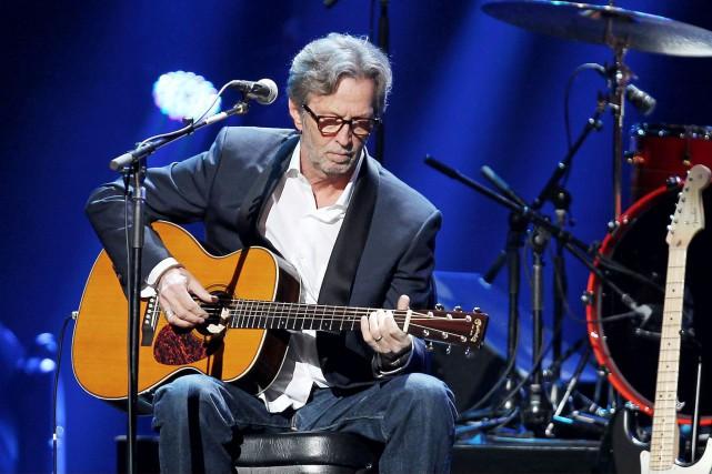 Eric Clapton, que l'on voit ici en 2012... (Archives AP, Dave Allocca)