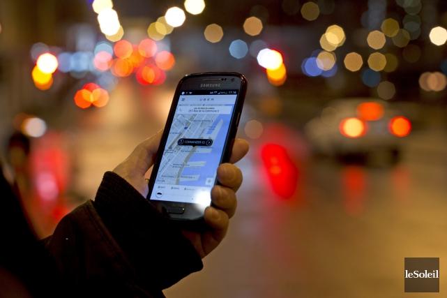 La concurrence directe d'UberX aux services de taxis... (Photothèque Le Soleil)
