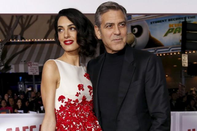 George Clooney et sa femme Amal à la... (PHOTO REUTERS)