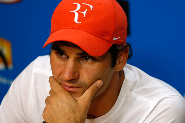 Roger Federer a subi une chirurgie arthroscopique en Suisse,... (Photo Vincent Thian, AP)