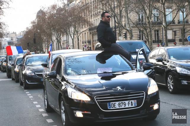 Uber soulève les passions un peu partout dans... (AP, Jacques Brinon)