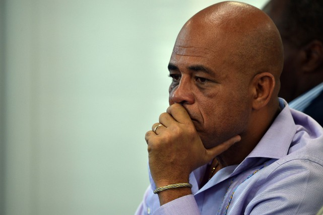 Le président haïtien, Michel Martelly... (PHOTO HECTOR RETAMAL, AFP)