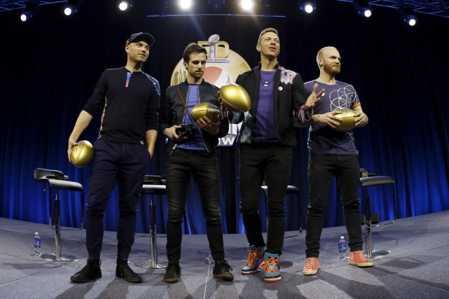 Les membres du groupe Jonny Buckland, Guy Berryman,... (Associated Press)