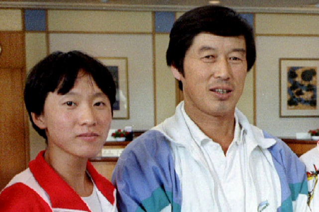 La coureuse chinoise Wang Junxia et l'entraîneur Ma Junren.... (Photo archives Reuters)