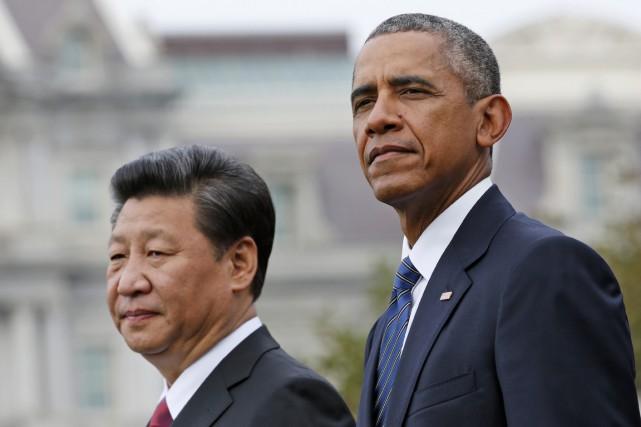 Les présidents américain Barack Obama et chinois Xi... (Photo Steve Helber, archives AP)