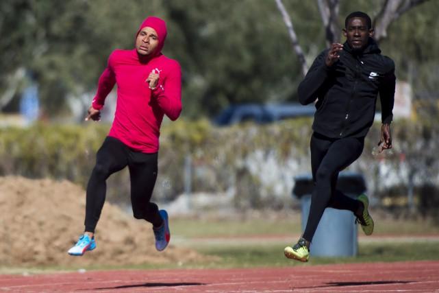 Andre De Grasse (à gauche) s'entraîne avec l'Ivoirien... (Photo Nathan Denette, La Presse Canadienne)
