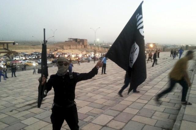 Un sympathisant du groupe État islamique dans une... (PHOTO ARCHIVES REUTERS)