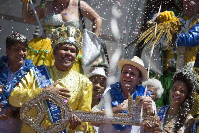 Au moment où le roi Momo donnait le... (AP, Leo Correa)