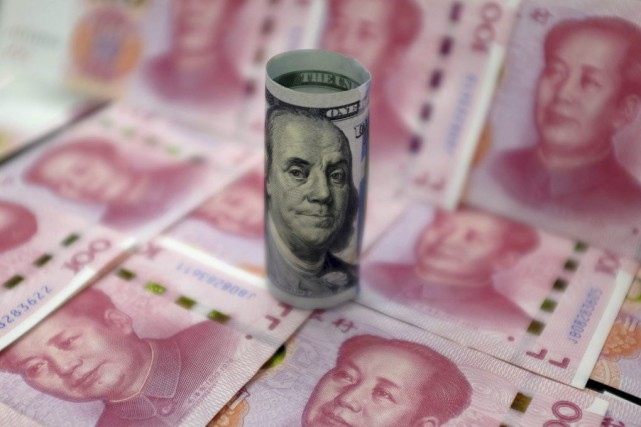 La Banque centrale chinoise (PBOC) vend des dollars américains... (PHOTO JASON LEE, ARCHIVES REUTERS)