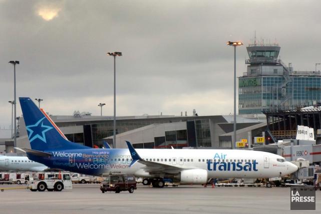 Les voyagistes Transat A.T. et Thomas Cook Group Airlines ont annoncé lundi la... (PHOTO BERNARD BRAULT, ARCHIVES LA PRESSE)