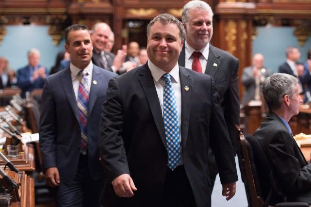 Sébastien Proulx, ministre de la Famille, accompagné duStéphane... (Photo Jacques Boissinot, archives La Presse Canadienne)