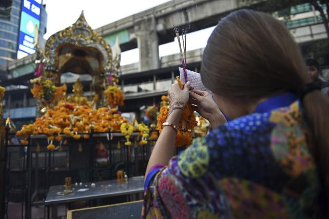 Une touriste en Thaïlande.... (Agence France-Presse, Christophe Archambault)