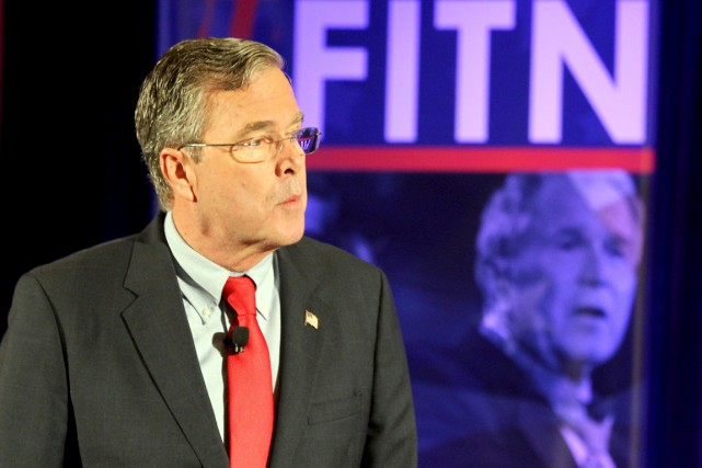 George W. Bush va faire publiquement campagne la... (Photo Reuters)