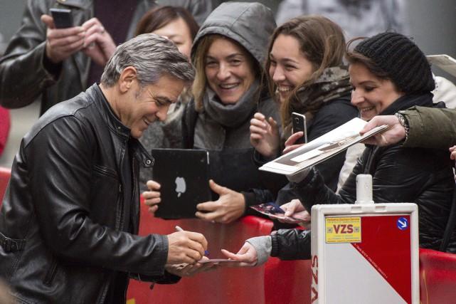 L'acteur George Clooney a fait courir les foules... (AP, Bernd von Jutrczenka)