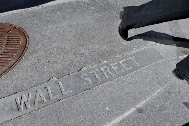 Wall Street a nettement monté hier, achevant sur une bonne note une semaine... (PHOTO STAN HONDA, ARCHIVES AFP)