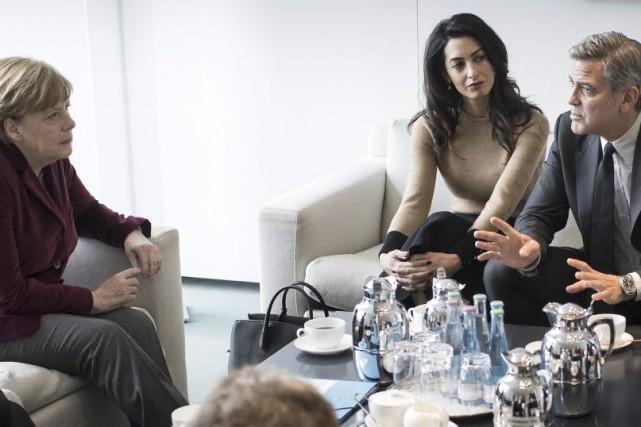 Angela Merkel, Amal Alamuddin et George Clooney.... (PHOTO REUTERS)