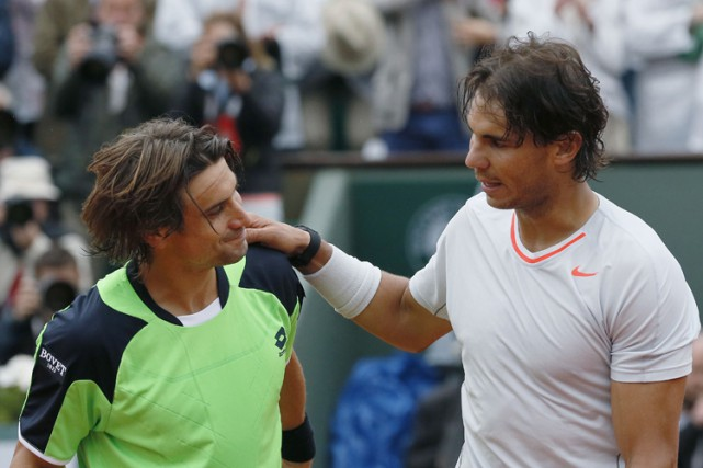 David Ferrer et Rafael Nadal après un match... (PHOTO AFP)