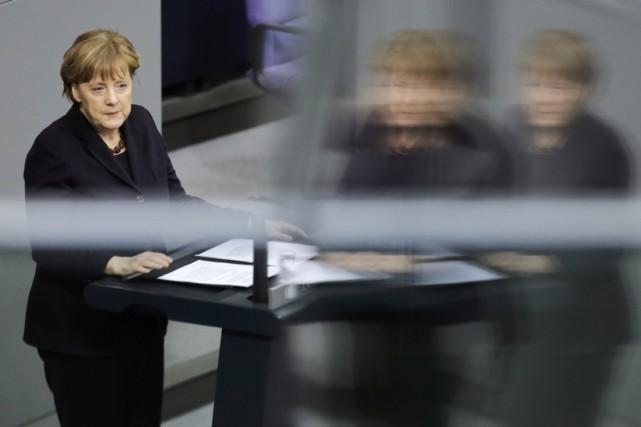 La chancelière allemande Angela Merkel... (PHOTO MARKUS SCHREIBER, AP)