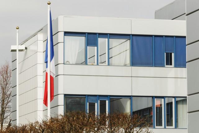 Une perquisition a été menée mercredi au siège... (PHOTO GEOFFROY VAN DER HASSELT, AFP)