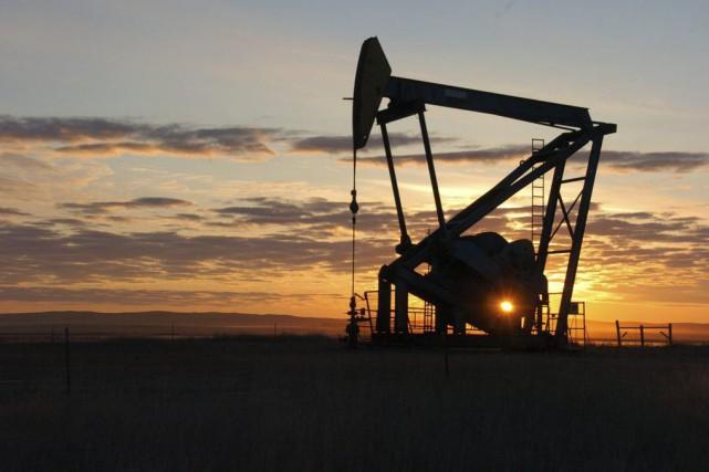 L'Iran a refusé mercredi de se rallier à quatre grands producteurs de pétrole... (Matthew Brown, Archives AP)