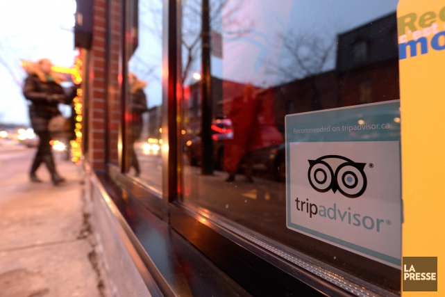 Une affiche en anglais mentionnant «Recommanded Trip Advisor».... (PHOTO BERNARD BRAULT, ARCHIVES LA PRESSE)