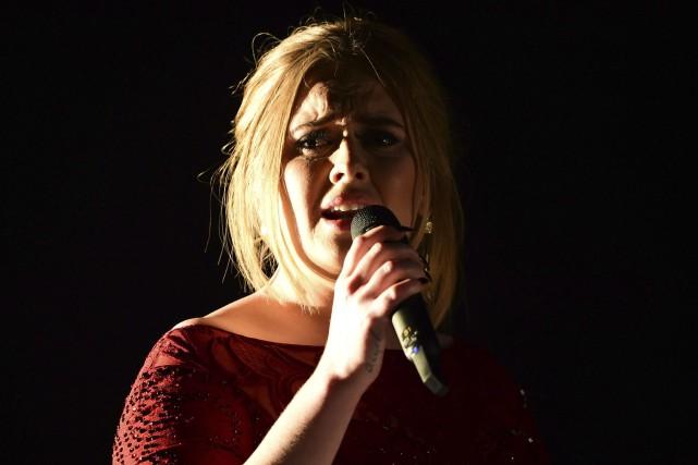 Adele a confessé avoir pleuré toute une journée... (AFP, Robyn Beck)