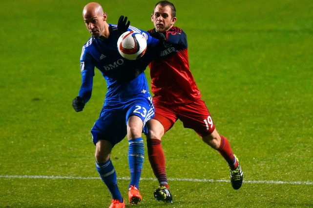 Laurent Ciman (à gauche) et Harry Shipp ont... (PHOTO MIKE DINOVO, ARCHIVES USA TODAY SPORTS)