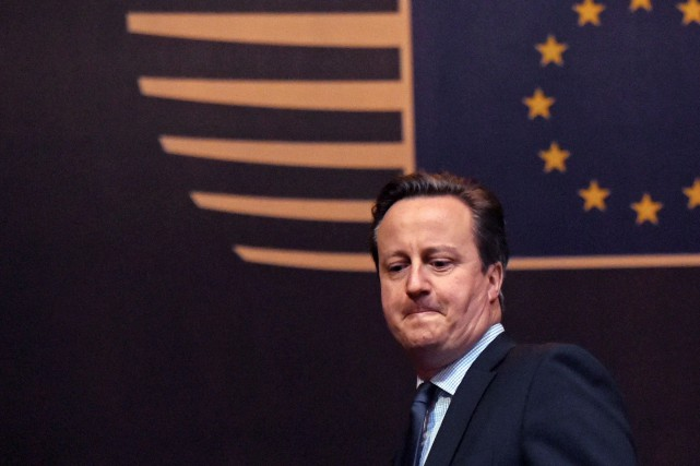 Le premier ministre britannique David Cameron... (AP, Geert Vanden Wijngaert)