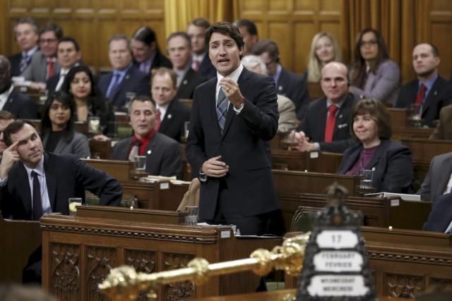 Les libéraux de Justin Trudeau obtiendraient 49% des... (PHOTO CHRIS WATTIE, REUTERS)
