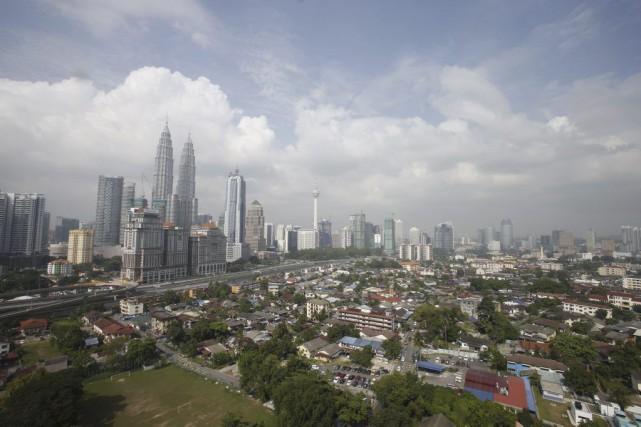 Les autorités malaisiennes ont arrêté des individus soupçonnés... (Photo Bazuki Muhammad, Reuters)